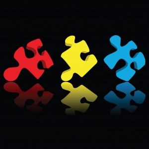 Puzzle pieces- multicolor with reflection over black