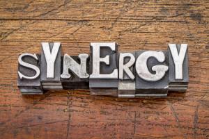 synergy word in vintage metal type printing blocks over grunge wood