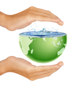 Hands around half earth globe with water splashing